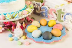 Easter brunch. Dessert table set with cake and cupcakes for Easter brunch Royalty Free Stock Image