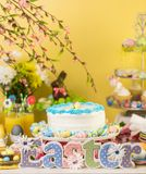 Easter brunch. Dessert table set with cake and cupcakes for Easter brunch Stock Photography