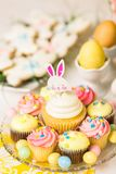 Easter brunch. Dessert table set with cake and cupcakes for Easter brunch Stock Photo