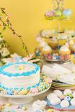 Easter brunch. Dessert table set with cake and cupcakes for Easter brunch Stock Images