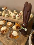 Easter Buffet Dessert Table Featuring a Chocolate Bunny with Big Ears.  stock photos