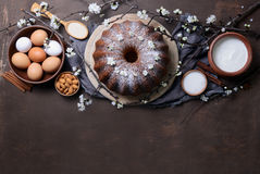 Easter bundt cake with ingredients. Easter bundt cake recipe concept, space for a text, view from above Royalty Free Stock Photos