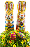 Easter bunnie. Chocolate bunnies in foil with chocolate eggs in the grass Royalty Free Stock Photos