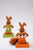 Easter-bunnies. Two small wooden easter-bunnies with easter-eggs Royalty Free Stock Images