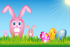 Easter bunnies. Illustration of easter bunnies on green meadow with easter eggs -  file added Royalty Free Stock Photos