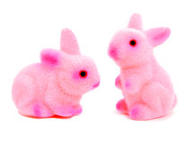 Easter bunnies. Two pink toy Easter bunnies on a white background Stock Photo
