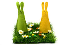 Easter bunnies. Sitting on the grass, isolated Royalty Free Stock Photography