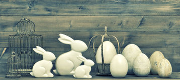 Easter Bunnies And Eggs On Wooden Background. Vintage Decoration