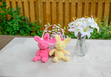Easter Bunnies, Basket and Lilies Display Stock Photos