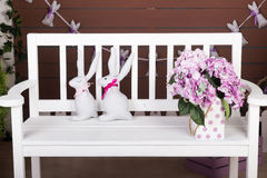 Easter bunnies. On the bench Royalty Free Stock Image