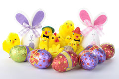 Easter bunnies and chicks with eggs over white Royalty Free Stock Photos