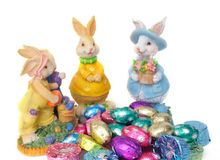 Easter Bunnies and Chocolates. Little Easter bunnies surrounds some foiled chocolates Stock Image