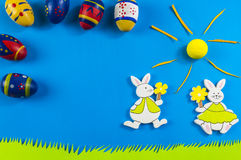 Easter bunnies on blue background Royalty Free Stock Images