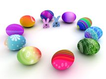 Easter bunnies and colorful eggs on white Stock Images