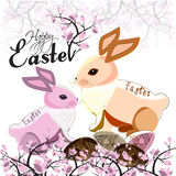 Easter bunnies. Couple of Easter bunnies with eggs and blooming magnolia vector illustration