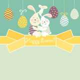 Easter bunnies and easter egg Stock Photos