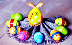Easter bunnies and easter eggs. On a sackcloth fan Stock Photo