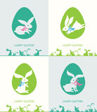 Easter bunnies and Easter eggs. Four cards with Easter bunnies and Easter eggs. Happy Easter vector illustration