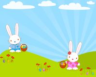 Easter_bunnies_egg Stock Images
