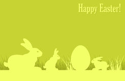 Easter bunnies and egg on grass Stock Photo