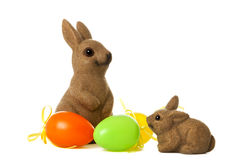 Easter bunnies and eggs. Adult and young easter bunny with three eggs Royalty Free Stock Photo