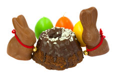 Easter  bunnies with eggs. Easter bunnies with eggs and cake isolated on white Royalty Free Stock Images