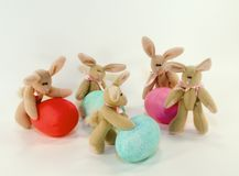 Easter bunnies and eggs. Five toy bunnies with colourful Easter eggs Stock Photo