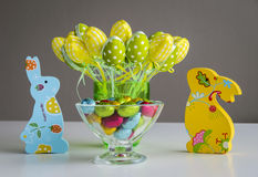 Easter bunnies with eggs and candies. Easter bunnies with eggs and colored candies Royalty Free Stock Photography