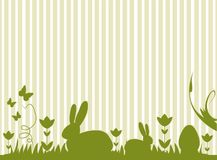 Easter bunnies and eggs on a meadow. Easter bunnies and eggs and butterflies on a meadow. Clean design with different silhouettes. Happy Easter Stock Images