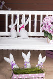 Easter bunnies. On the floor and on the bench Stock Photo