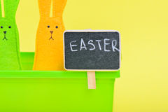 Easter Bunnies in flower pot with black board Royalty Free Stock Images