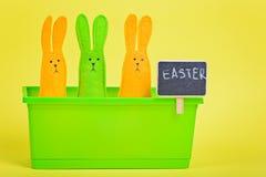 Easter Bunnies in flower pot with blackboard Stock Photo