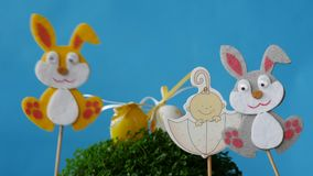 The Easter bunnies found Easter eggs and baby in umbrella. Free space to add text stock video footage