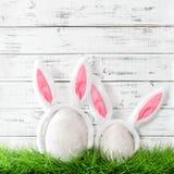Easter bunnies green grass Eggs decoration. Easter bunnies in green grass. Eggs decoration Stock Image
