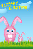 Easter bunnies on green meadow. Illustration of easter bunnies on green meadow and HAPPY EASTER lettering - file added stock illustration
