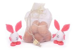 Easter bunnies out of the eggshell and a bag of eggs Stock Photography