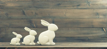 Easter bunnies over wooden background Stock Images