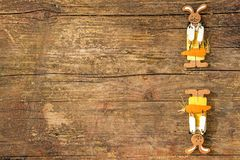 Easter bunnies on a plank with copy space. Easter bunnies on a wooden plank with copy space Royalty Free Stock Images
