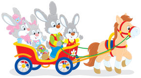 Easter bunnies riding a carriage Stock Images
