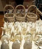 Easter bunnies. Rows  of elegant ceramic rabbits, display for Easter  sale Stock Photo