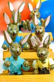 Easter bunnies at school. With painted eggs in the background stock image