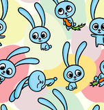 Easter bunnies on seamless pattern background Royalty Free Stock Image