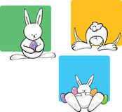 Easter Bunnies set. Easter bunnies in various positions on color blocks Royalty Free Stock Image