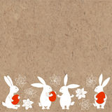 Easter bunnies and spring flowers daffodils. Vector illustration on kraft background with space for text. Easter festive background with rabbits and spring Royalty Free Stock Images
