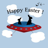 Easter bunnies in a UFO. Abstract colorful illustration with two Easter bunnies flying in a UFO among clouds. Easter card Royalty Free Stock Images