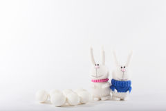 Easter bunnies and white eggs Royalty Free Stock Photos