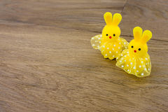Easter bunnies wooden background Stock Photos