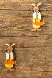 Easter bunnies on a plank with copy space. Easter bunnies on a wooden plank with copy space Royalty Free Stock Image
