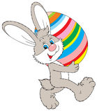 Easter Bunny. Vector clip-art of Easter Bunny bearing a colorfully painted egg