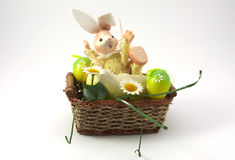 Easter bunny. And eggs in the bascet Stock Images